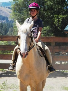 Cymone Ringgold riding her horse Feather in Twisp Washington